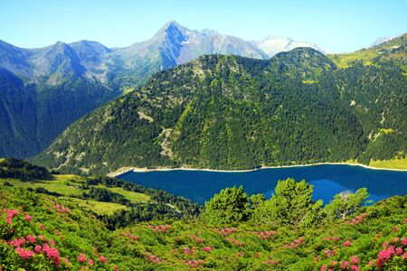 Beautiful mountain landscape with lake in French Pyrenees. Lac de l'Oule in Neouvielle National Nature Reserve.