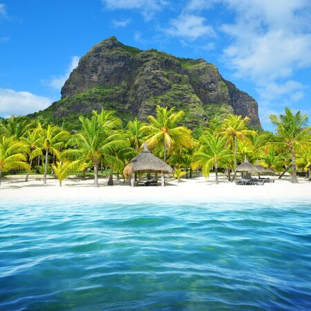 Beautiful sandy beach with Le Morne Brabant on the south of Mauritius island. Tropical landscape.