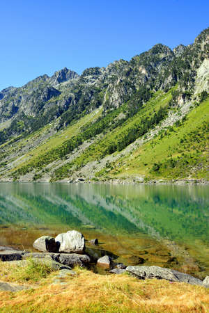 Gaube lake in the Pyrenees, France. Beautiful mountain landscape in sunny day.