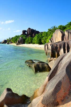 Beatiful beach Anse Source d'Argent with big granite rocks in sunny day. La Digue Island, Seyshelles. Luxury travel destination.