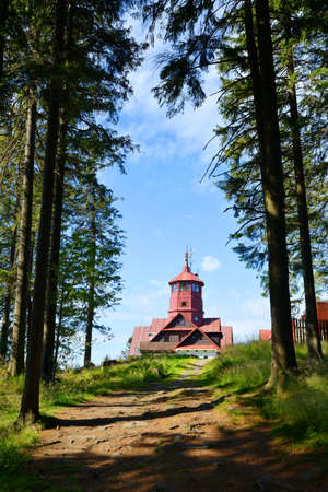 ZELEZNA RUDA, CZECH REPUBLIC - JULY 28, 2020: Lookout tower on the top of Pancir mountain in National Park Sumava. Publikacyjne