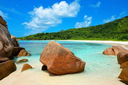 Anse Cocos beach with big granite stones in La Digue Island, Indian Ocean, Seychelles.