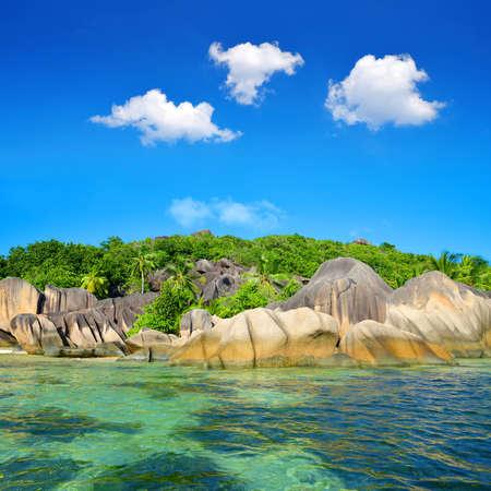 Beatiful beach Anse Source d'Argent with big granite stones in La Digue Island, Indian Ocean, Seychelles. Luxury travel destination.