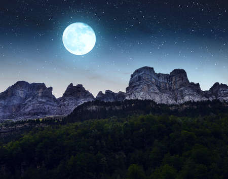 Mountain landscape in the night sky with moon. Ordesa y Monte Perdido National park, Huesca, Aragon, Spain. Stockfoto