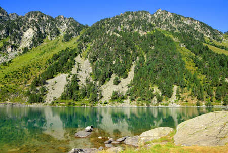 Gaube lake near village Cauterets in the Hautes-Pyrenees department, France, Europe. Beautiful mountain landscape in summer day.