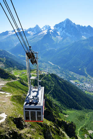 CHAMONIX, FRANCE - JULY 18, 2021: Cable car arriving at the Le Brevent station from the city of Chamonix.