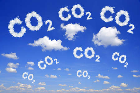 Blue sky with CO2 text from clouds. Global warming or change climate concept. Environmental problems. Growing Carbon Dioxide in the atmosphere