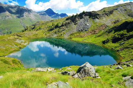 Mountain lake Lago di Loie in Gran Paradiso National Park, Lillaz, Cogne, Aosta valley, Italy. Summer landscape in the Alps.