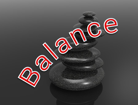 spa stones on simple neutral background and the word Balance