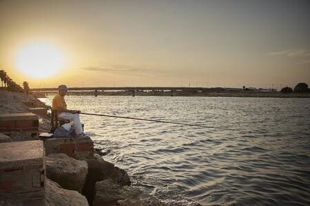 Some pictures of a some fishermen front a mediterranean sea