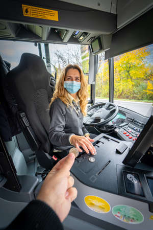 a driver woman at work with her mask