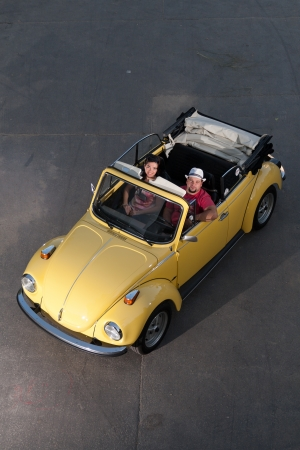 vw: Young couple in a VW Bug Convertible Editorial