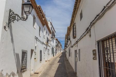 altea: White houses in a narrow street in Altea, Spain