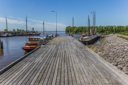 Wooden jetty in the harbor of Zoutkamp photo