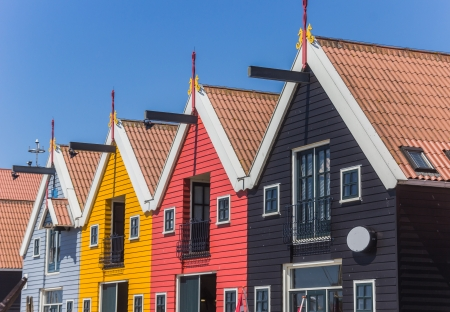 Colorful row of houses at the harbor of Zoutkamp photo
