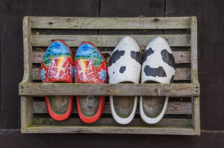 klompen: Two pairs of wooden shoes in a rack