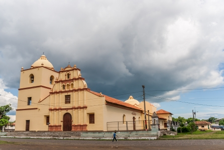 suburbian: Suburbian catholic church in Leon against a cloudy sky
