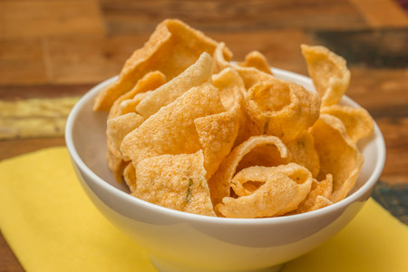 Traditional chinese prawn crackers in a white bowl