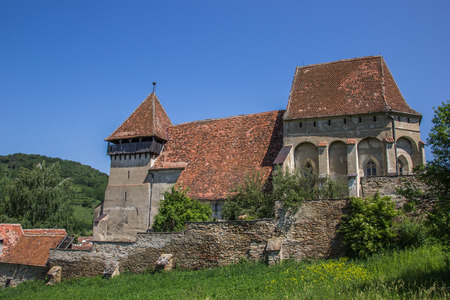 Fortified church in the town of Copsa Mare, Romania photo