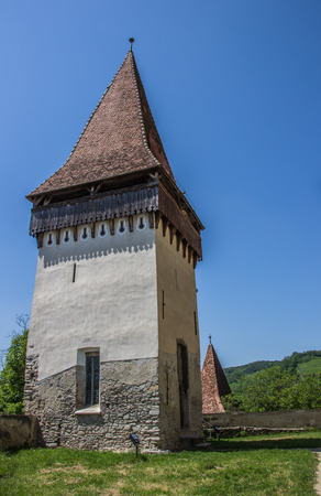 Tower of the fortified church of Biertan, Romania photo