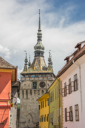 saxon: Clock tower and colorful houses in Sighisoara, Romania
