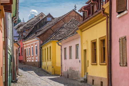 Street with colorful houses in Sighisoara, Romania