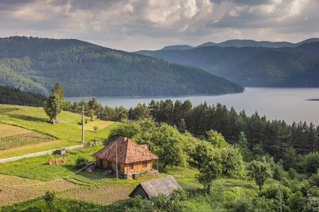 Little house on the the shore of Lake Bicaz, Romania photo