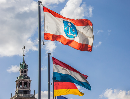leer: Flag of the city Leer in front of the Rathaus, Germany