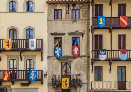 Building with medieval shields at the Piazza Grande in Arezzo, Italy