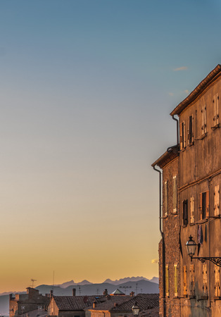 volterra: Sunset light over old buildings in Volterra, Italy