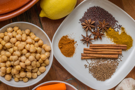 mustard seed: Moroccan spices, lemon, chick peas, star anise, cinnamon, mustard seed Stock Photo