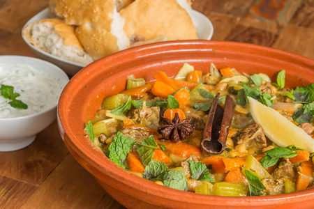 Moroccan tagine dish with chick peas, lamb, carrots, celery, lemon, onion, cinnamon, star anise Imagens - 32600343