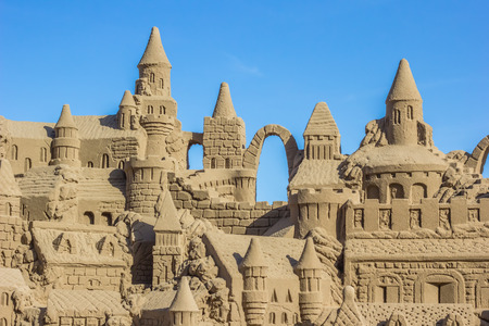 sand castle: Sand castle with several towers against a blue sky
