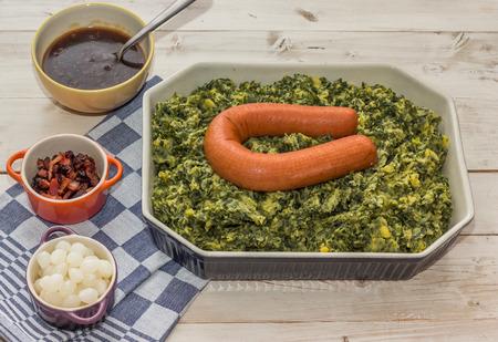 smoked sausage: Typical dutch dish boerenkool with kale, mashed potatoes, smoked sausage, bacon and gravy