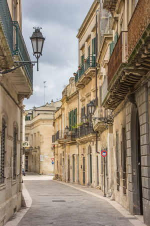 Street with old houses in the historical center of Lecce, Italy