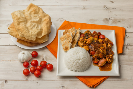 basmati rice: Indian chicken jalfrezi with basmati rice, naan bread and pappadums