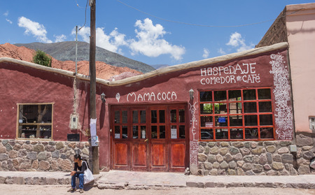 siete: Argentine woman waiting for a hostel in Purmamarca, Argentina
