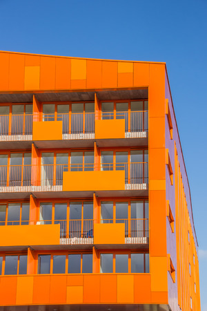 appartment: Balconies at a modern orange appartment building in Groningen, Netherlands Editorial
