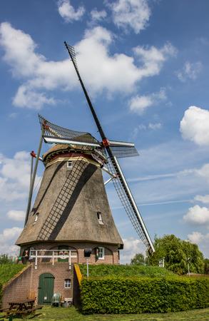 beatrix: Beatrix mill in Winssen, the Netherlands against a blue sky