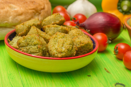 falafel: Falafel and other middle eastern ingredients on a green table