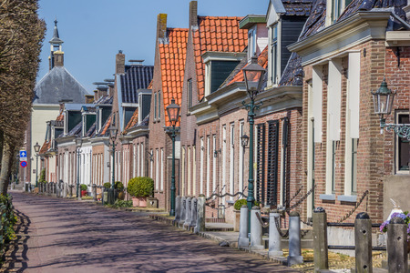 Old houses at the central street in IJlst, Holland Stock Photo