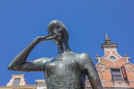 Bronze statue of Mariken van Nieumeghen in front of an old facade at the Grote Markt in Nijmegen Netherlands