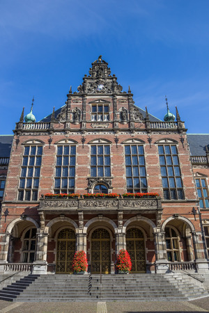 old school bike: Front view of the main building of the Groningen University, Holland