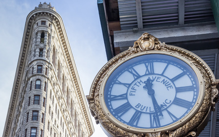 flatiron: Clock and the Flatiron Building in New York City, USA
