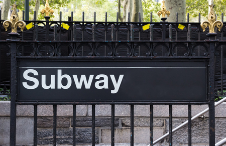 bryant: New York City Subway sign on a fence near Bryant Park Stock Photo