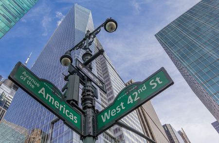 street lantern: Street sign at an intersection in New York City, America