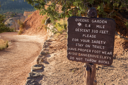 wooden trail sign: Wooden sign at Queens Garden trail in Bryce Canyon National Park, Utah, USA Stock Photo