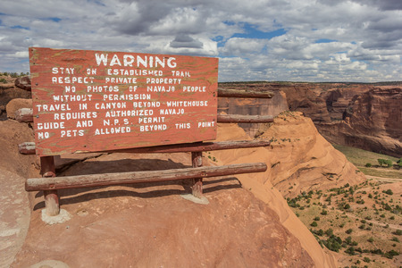 wooden trail sign: Warning sign at white house trail in Canyon de Chelly National Monument, Arizona, USA