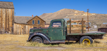 rusty car: Panorama of an old rusty car in Bodie State Park, California
