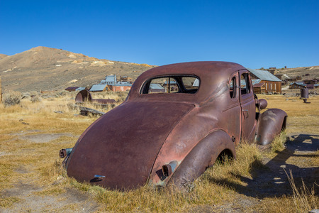 rusty car: Rusty car wreck in Bodie State Historic Park, California, USA Stock Photo